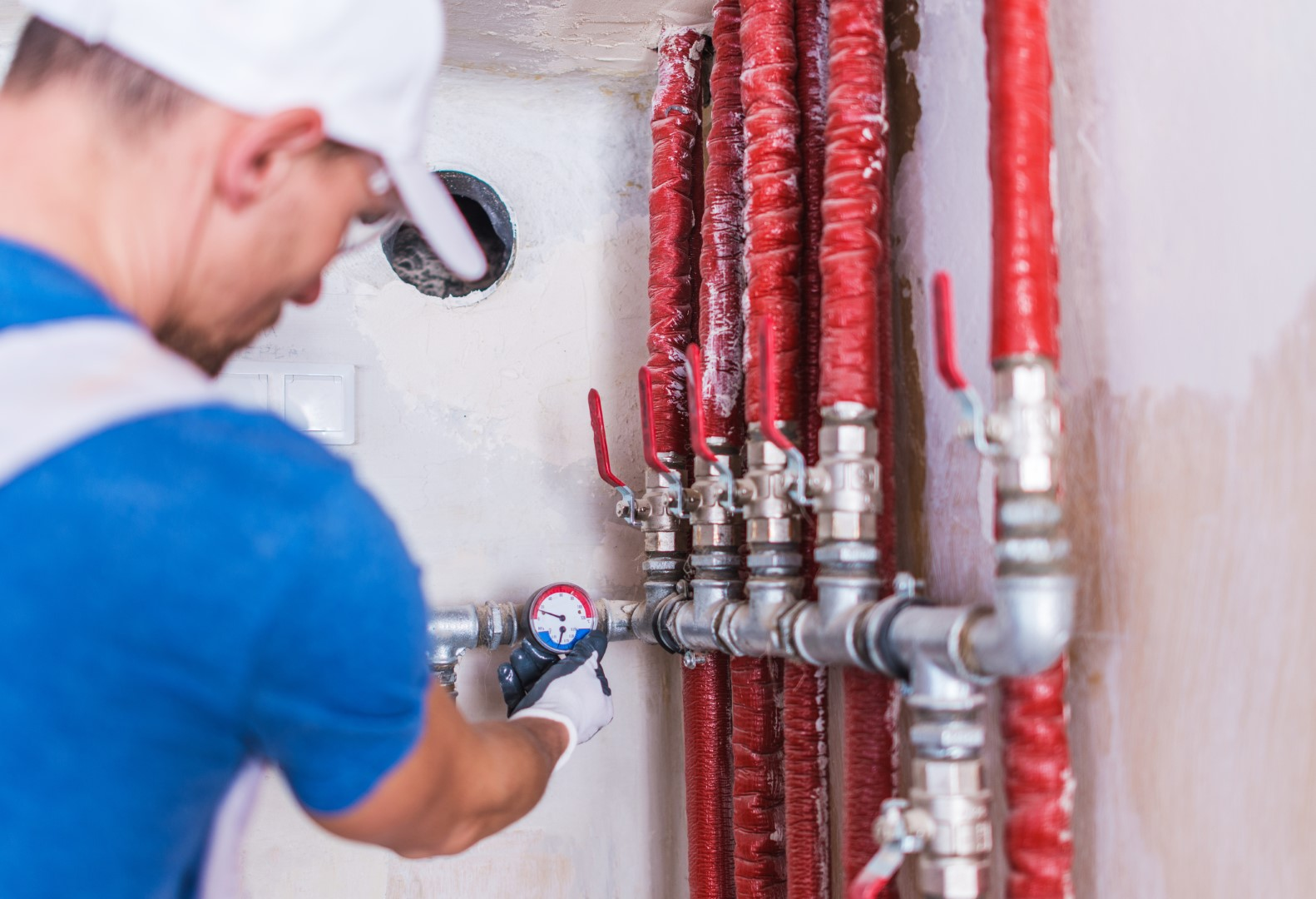 Plumber Checking on Water Supply